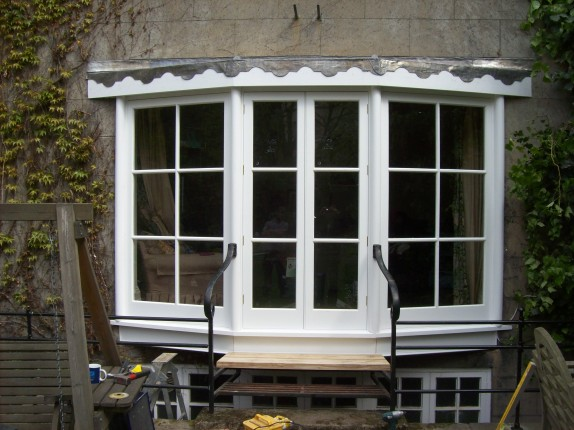 Bay window, inclusive of french doors
